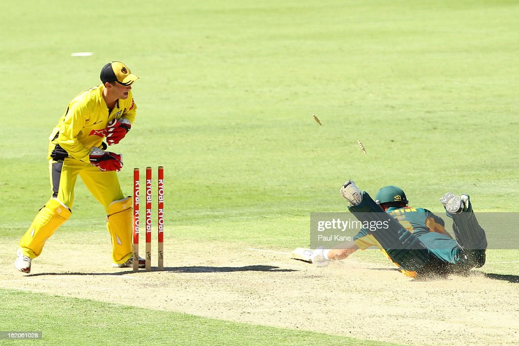 Sam Whiteman of the Warriors removes the bails to run out Matt Johnston of the Tigers during the Ryobi One Day Cup match between the Western Australia Warriors and the Tasmanian Tigers at the WACA on February 19, 2013 in Perth, Australia.