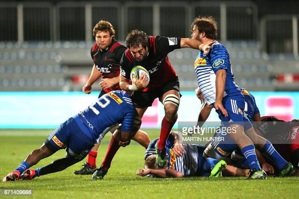 Sam Whitlock of the Canterbury Crusaders is held in a tackle during the Super Rugby match between New Zealand's Canterbury Crusaders and South...