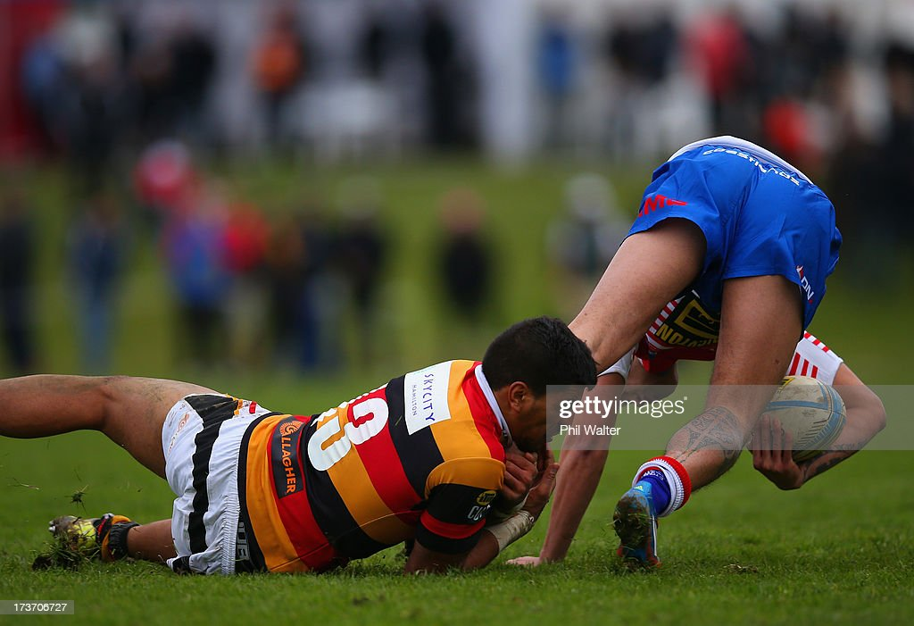 Sam Williams of Horowhenua-Kapiti is tackled by Dylan Collier of Waikato during the Ranfurly Shield match between Waikato and Horowhenua-Kapiti at the Morrinsville Domain on July 17, 2013 in Morrinsville, New Zealand.