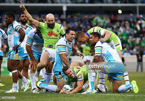 Sam Williams of the Raiders scores a try during the round nine NRL match between the Canberra Raiders and the GOld Coast Titans at GIO Stadium on May...