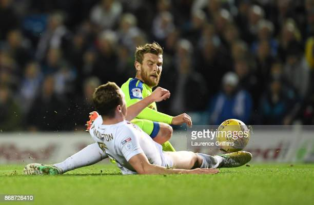 Sam Winall of Derby County battles for the ball with Matthew Pennington of Leeds United during the Sky Bet Championship match between Leeds United...