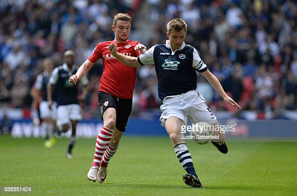 Sam Winnall of Barnsley FC and Tony Craig of Millwall FC during the Sky Bet League One Play Off Final between Barnsley and Millwall at Wembley...