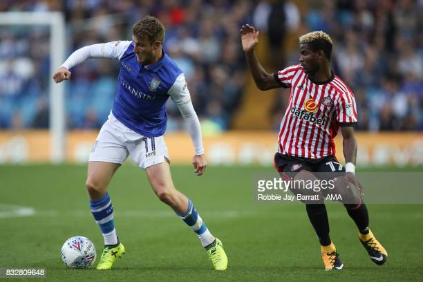 Sam Winnall of Sheffield Wednesday and Didier Ndong of Sunderland during the Sky Bet Championship match between Sheffield Wednesday and Sunderland at...