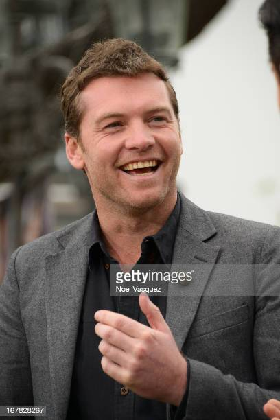 Sam Worthington visits 'Extra' at The Grove on April 30 2013 in Los Angeles California