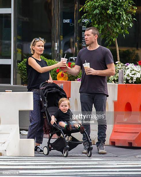 Sam Worthington with Lara Bingle and their baby Rocket Zot are seen buying fruit shakes from a street vendor in TriBeCa on June 11 2016 in New York...