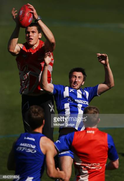 Sam Wright of the Kangaroos suffers a corked lower back from Daniel Currie of the Kangaroos who marks the ball during a North Melbourne Kangaroos AFL...