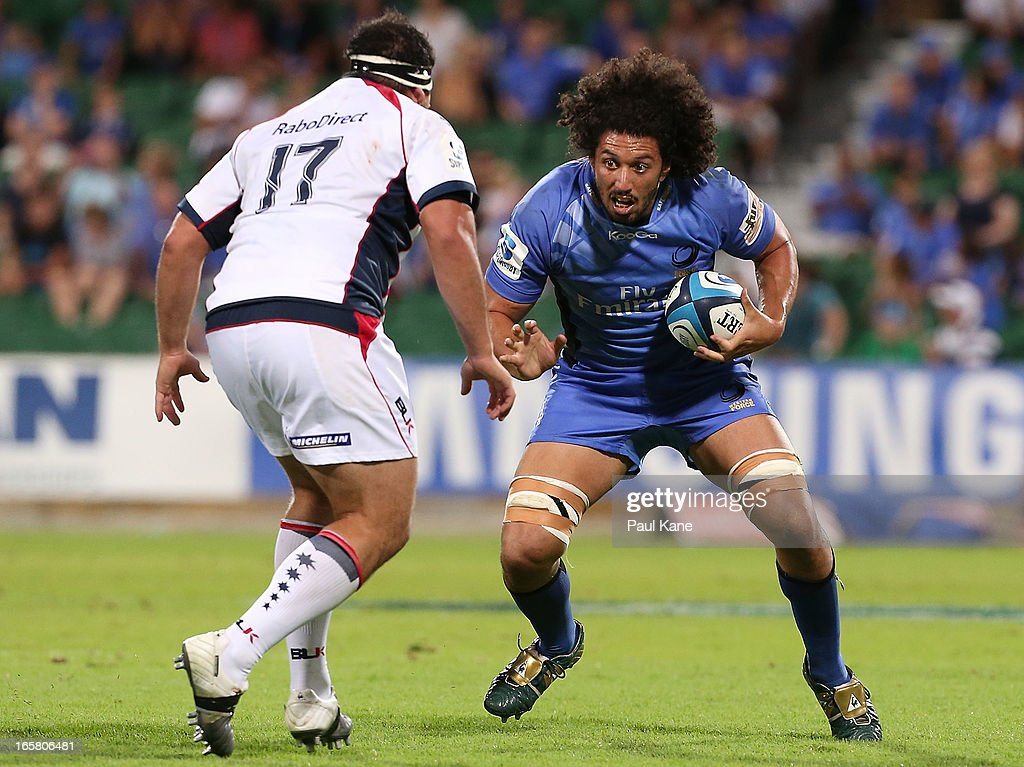 Sam Wykes of the Force looks to evade Laurie Weeks of the Rebels during the round eight Super Rugby match between the Western Force and the Melbourne Rebels at nib Stadium on April 6, 2013 in Perth, Australia.