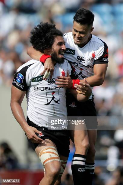 Sam Wykes of the Sunwolves celebrates with his team mate Yu Tamura of the Sunwolves after scoring a try during the Super Rugby Rd 14 match between...
