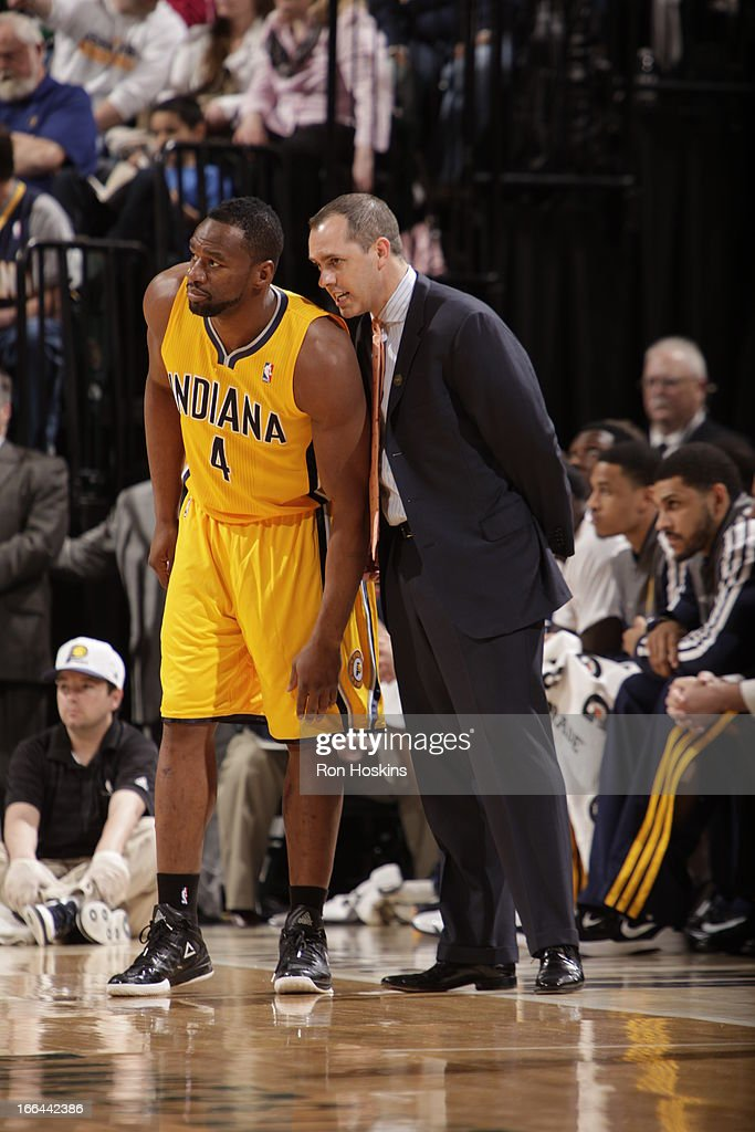 Sam Young #4 of the Indiana Pacers and Head Coach Frank Vogel have a conference against the Brooklyn Nets on April 12, 2013 at Bankers Life Fieldhouse in Indianapolis, Indiana.