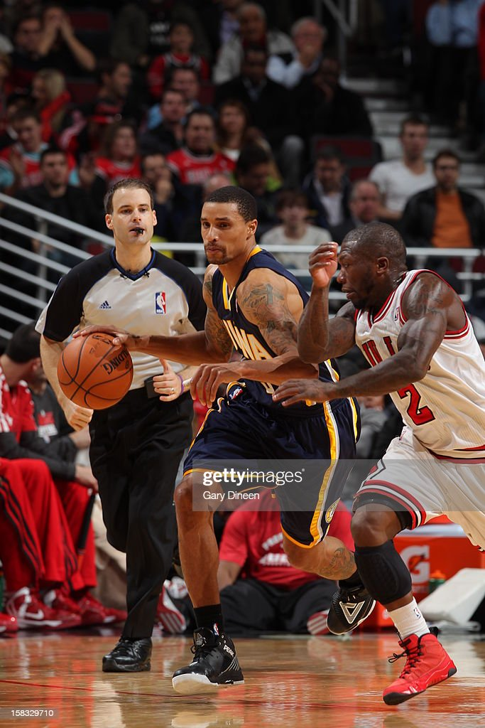 Sam Young #4 of the Indiana Pacers brings the ball up court while guarded by <a gi-track='captionPersonalityLinkClicked' href=/galleries/search?phrase=Nate+Robinson&family=editorial&specificpeople=208906 ng-click='$event.stopPropagation()'>Nate Robinson</a> #2 of the Chicago Bulls on December 4, 2012 at the United Center in Chicago, Illinois.