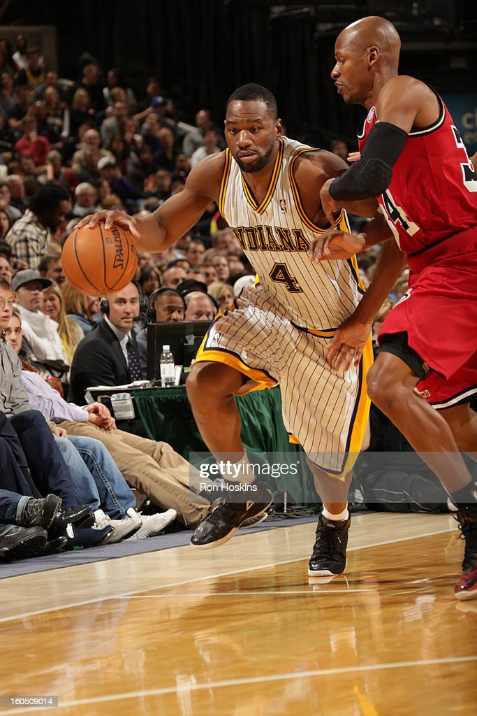 Sam Young #4 of the Indiana Pacers dribbles the ball up the floor against <a gi-track='captionPersonalityLinkClicked' href=/galleries/search?phrase=Ray+Allen&family=editorial&specificpeople=201511 ng-click='$event.stopPropagation()'>Ray Allen</a> #34 of the Miami Heat on February 1, 2013 at Bankers Life Fieldhouse in Indianapolis, Indiana.