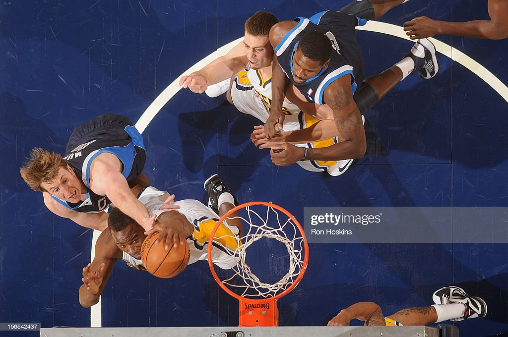 Sam Young #4 of the Indiana Pacers fights for the rebound against <a gi-track='captionPersonalityLinkClicked' href=/galleries/search?phrase=Troy+Murphy&family=editorial&specificpeople=201794 ng-click='$event.stopPropagation()'>Troy Murphy</a> #6 of the Dallas Mavericks on November 16, 2012 at Bankers Life Fieldhouse in Indianapolis, Indiana.