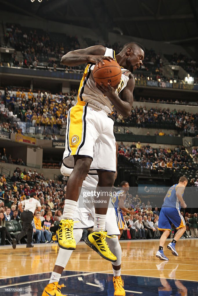 Sam Young #4 of the Indiana Pacers grabs a rebound against the Golden State Warriors on February 26, 2013 at Bankers Life Fieldhouse in Indianapolis, Indiana.