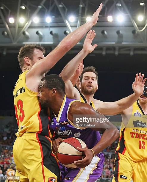 Sam Young of the Kings controls the ball as the Tigers defend during the round 21 NBL match between the Melbourne Tigers and the Sydney Kings at...