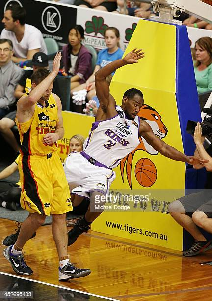 Sam Young of the Kings cops a heavy bump from Mark Worthington of the Tigers during the round eight NBL match between the Melbourne Tigers and the...