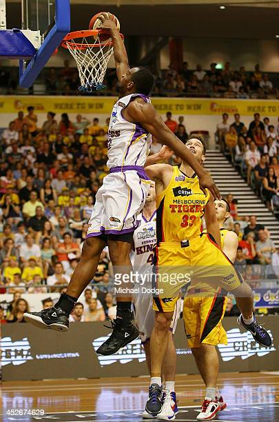 Sam Young of the Kings slam dunks over Mark Worthington of the Tigers during the round eight NBL match between the Melbourne Tigers and the Sydney...