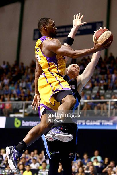 Sam Young of the Sydney Kings lays up the ball over Gary Wilkinson of the Breakers during the round 22 NBL match between the New Zealand Breakers and...