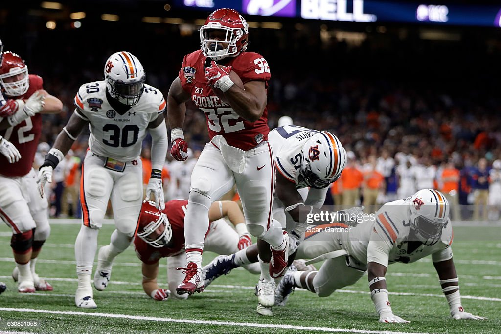 Samaje Perine #32 of the Oklahoma Sooners reacts after scoring a touchdown against the Auburn Tigers during the Allstate Sugar Bowl at the Mercedes-Benz Superdome on January 2, 2017 in New Orleans, Louisiana.