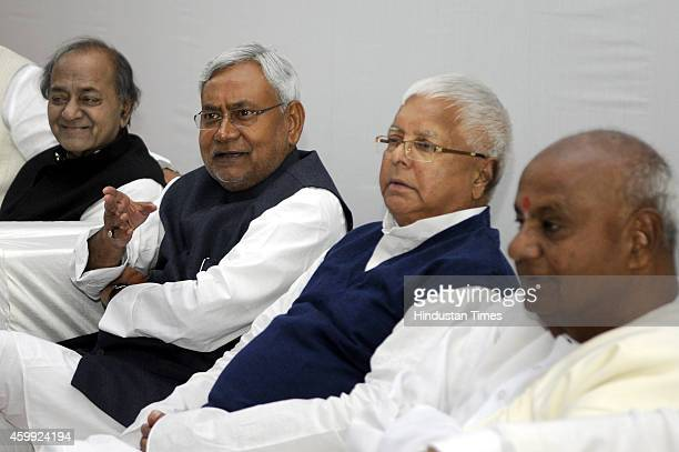 Samajwadi Janata Party Chief Kamal Morarka JD leader Nitish Kumar and RJD Chief Lalu Prasad Yadav during a meeting formation of a new alliance at...