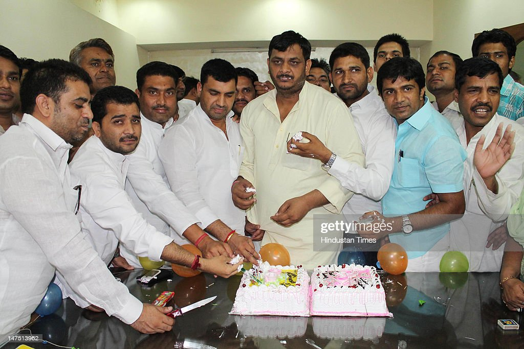 Samajwadi party activists & workers celebrated the birthday of their leader & UP Chief Minister Akhilesh Yadav at a local office of Samajvadi party at Sector 22 on July 1, 2012 in Noida, India. Akhilesh Yadav was born on July 1, 1973 and the youngest chief minister of Uttar Pradesh. He was elected to the Lok Sabha from Kannauj in a by-election of 2000 for the very first time and spearheaded the campaign to bring the Samajwadi Party back to power in the U.P. Assembly election 2012.