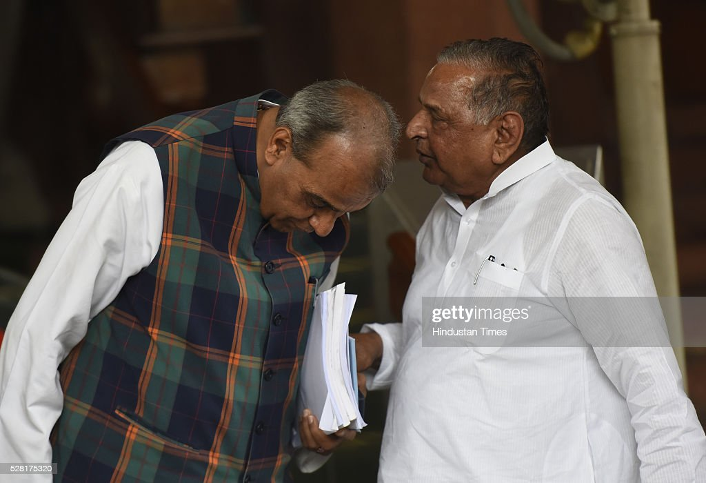 Samajwadi Party Chief and Lok Sabha MP Mulayam Singh Yadav having a conversation with BJP MP Jagdambika Pal during the Parliament session on May 4, 2016 in New Delhi, India. Congress walks out of the House demanding time-bound Supreme Court-monitored CBI probe on the AgustaWestland helicopter deal.