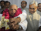 Samajwadi Party chief Mulayam Singh congratulated by Bihar Chief Minister Nitish Kumar after merger of six parties on April 15 2015 in New Delhi...