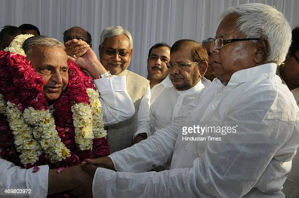 Samajwadi Party chief Mulayam Singh congratulated by RJD supremo Lalu Prasad and JD chief Sharad Yadav and Bihar Chief Minister Nitish Kumar after...