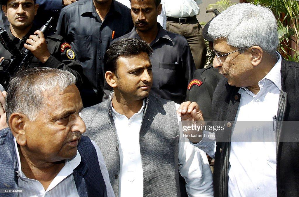 Samajwadi Party chief Mulayam Singh with son Akhilesh Yadav and CPIM general secretory Prakash Karat leave after attending parliament budget session...