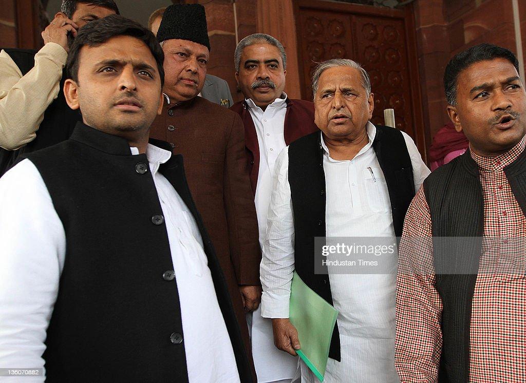 Samajwadi Party Chief Mulayam Singh with son Akhilesh Yadav and party leaders at Parliament House on December 22 2011 in New Delhi India Lok Shabha...