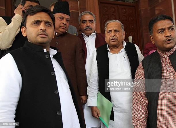 Samajwadi Party Chief Mulayam Singh with son Akhilesh Yadav and party leaders at Parliament House on December 22 2011 in New Delhi India Lok Shabha...