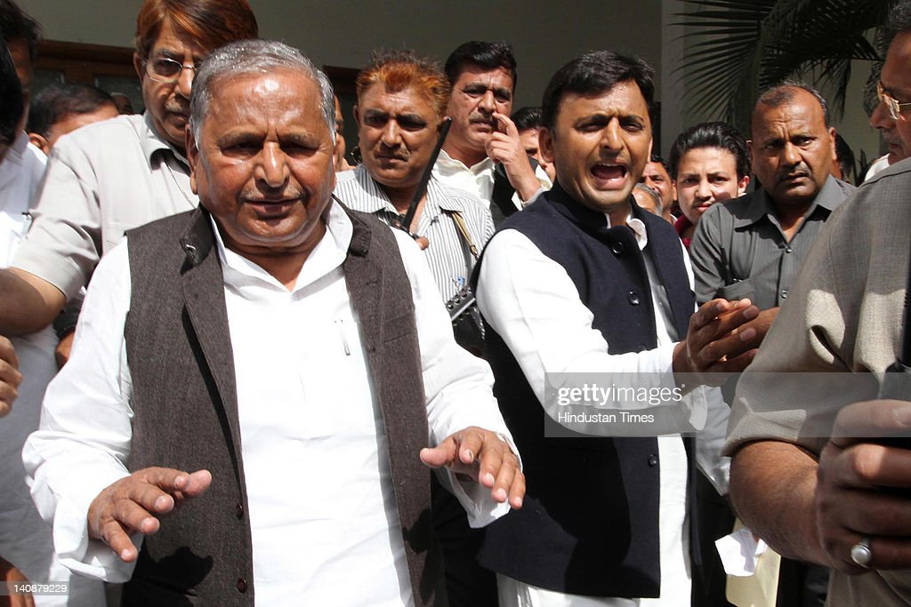 Samajwadi Party chief <a gi-track='captionPersonalityLinkClicked' href=/galleries/search?phrase=Mulayam+Singh+Yadav&family=editorial&specificpeople=689640 ng-click='$event.stopPropagation()'>Mulayam Singh Yadav</a> (L) and his son and party state unit president Akhilesh Yadav arrive for the party parliamentary board meeting at the party office on March 7, 2012 in Lucknow, India. According to some sources, many board members pitched for Akhilesh as the Chief Minister during the party parliamentary board meeting. However the final decision will be made by <a gi-track='captionPersonalityLinkClicked' href=/galleries/search?phrase=Mulayam+Singh+Yadav&family=editorial&specificpeople=689640 ng-click='$event.stopPropagation()'>Mulayam Singh Yadav</a> after meeting with newly-elected legislators.