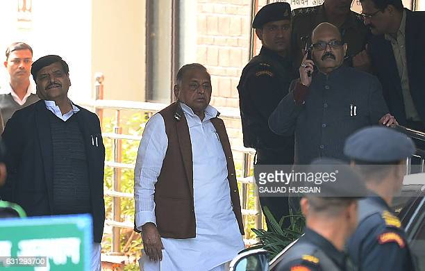 Samajwadi Party chief Mulayam Singh Yadav and other party leaders Shivpal Yadav and Amar Singh arrive at Election Commission of India's office in New...