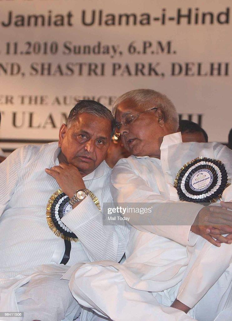 Samajwadi party chief Mulayam Singh Yadav and RJD leader Lalu Prasad Yadav during Securing Justice Conference in east Delhi on Sunday April 11 2010