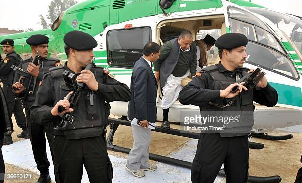 Samajwadi Party chief Mulayam Singh Yadav gets down from the helicopter to attend the party rally on January 8 2012 in Barabanki India Kickstarting...
