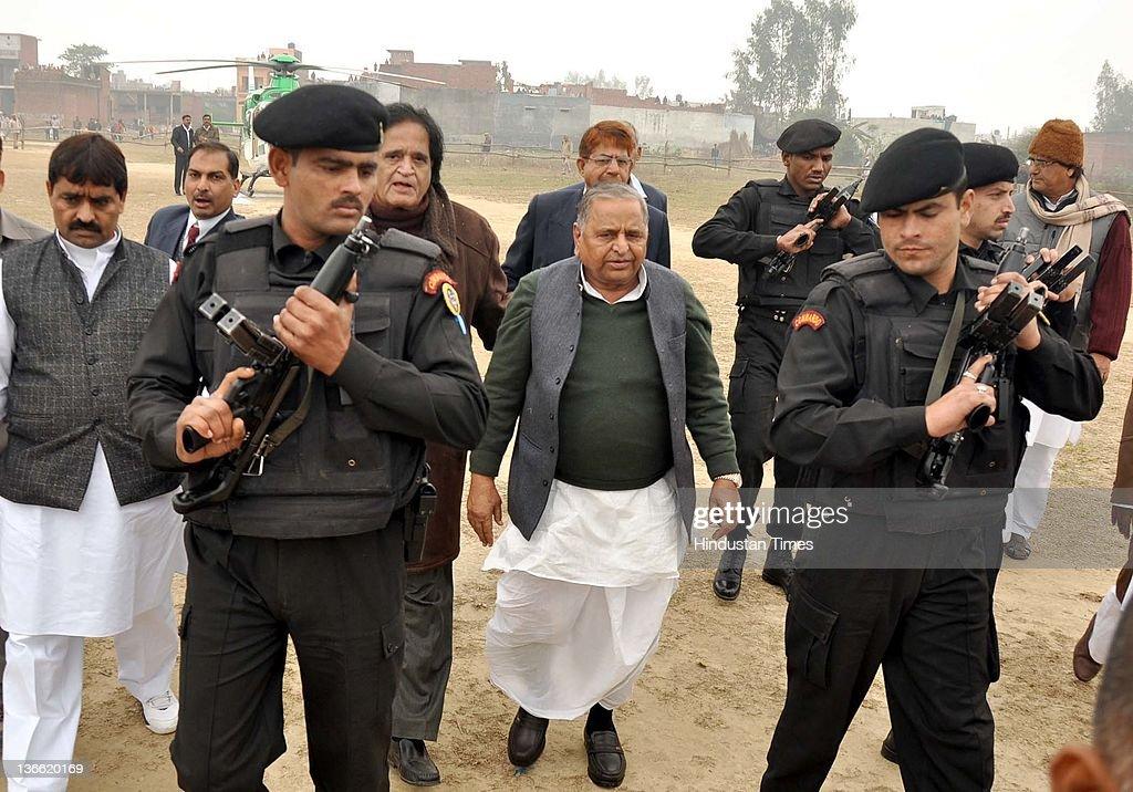Samajwadi Party chief Mulayam Singh Yadav is escorted toward the party rally on January 8 2012 in Barabanki India Kickstarting his election campaign...