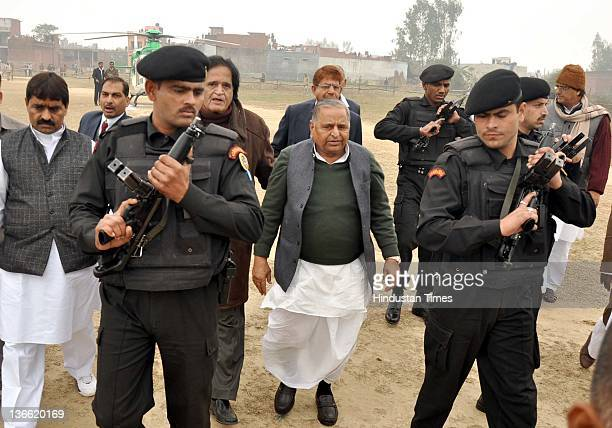 Samajwadi Party chief Mulayam Singh Yadav is escorted toward the party rally on January 8 2012 in Barabanki India Kickstarting his election campaign...