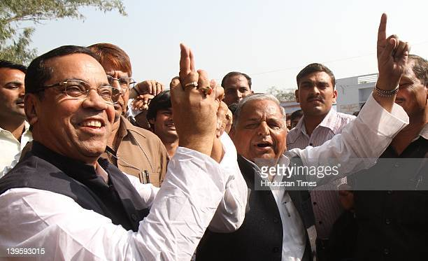 Samajwadi party chief Mulayam Singh Yadav showing ink marked finger after casting his vote at Safai Junior High School during fifth phase of assembly...