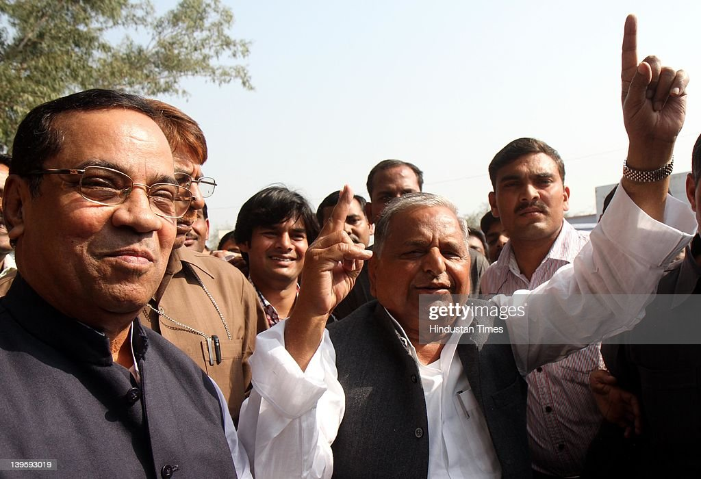 Samajwadi party chief Mulayam Singh Yadav(R) showing ink marked finger casting his vote at Safai Junior High School during fifth phase of assembly elections in Uttar Pradesh on February 23, 2012 in Etawah, India. Polling for 49 seats, spread over 13 districts of Uttar Pradesh, went on peacefully with more than 59 percent voters exercised their franchise.