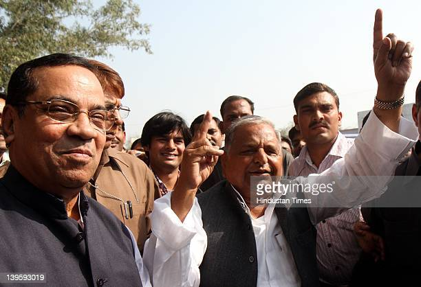 Samajwadi party chief Mulayam Singh Yadav showing ink marked finger casting his vote at Safai Junior High School during fifth phase of assembly...