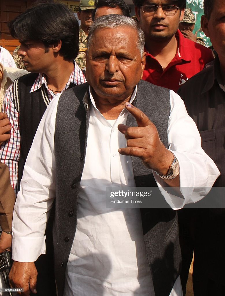 Samajwadi party chief Mulayam Singh Yadav shows his ink marked finger casting his vote at Safai Junior High School during fifth phase of assembly elections in Uttar Pradesh on February 23, 2012 in Etawah, India. Polling for 49 seats, spread over 13 districts of Uttar Pradesh, went on peacefully with more than 59 percent voters exercised their franchise.