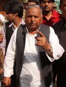 Samajwadi party chief Mulayam Singh Yadav shows his ink marked finger casting his vote at Safai Junior High School during fifth phase of assembly...