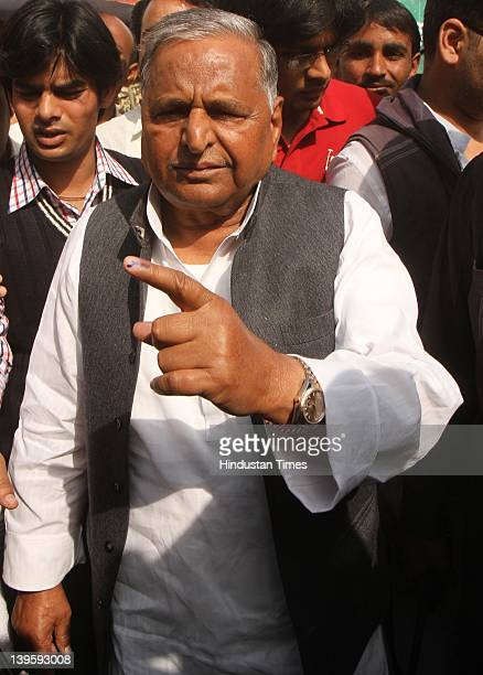 Samajwadi party chief Mulayam Singh Yadav shows his ink marked finger after casting his vote at Safai Junior High School during fifth phase of...