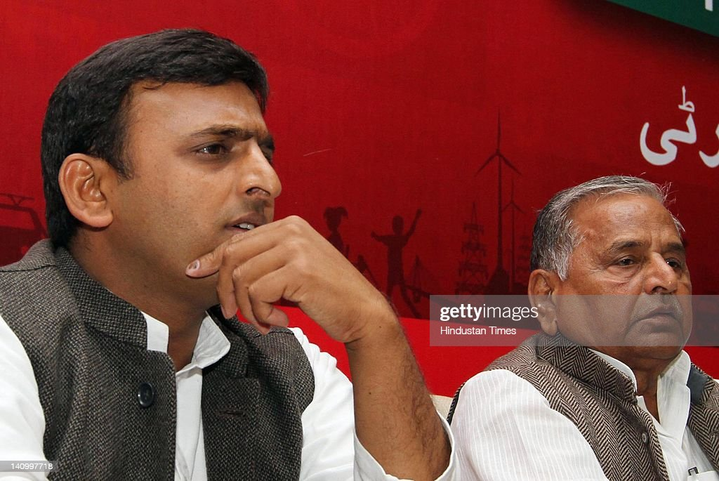 Samajwadi Party chief <a gi-track='captionPersonalityLinkClicked' href=/galleries/search?phrase=Mulayam+Singh+Yadav&family=editorial&specificpeople=689640 ng-click='$event.stopPropagation()'>Mulayam Singh Yadav</a> (R) sits with his son Akhilesh Yadav at press conference at the party office on March 9, 2012 in Lucknow, India. According to some media reports Yadav is likely to be selected the new Chief Minister of Uttar Pradesh in SP legislature party Meeting to be held on March 10, 2012.