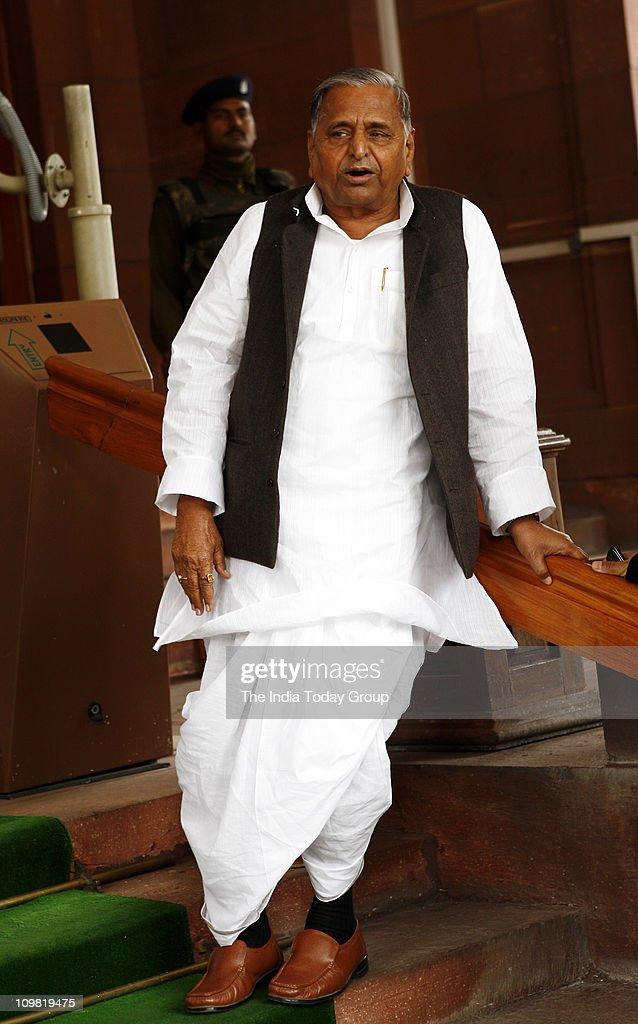 Samajwadi Party chief Mulayam Singh Yadav walks out of Parliament on Friday March 4 2011