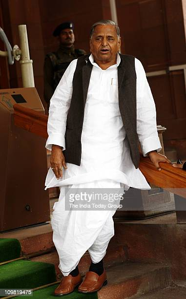 Samajwadi Party chief Mulayam Singh Yadav walks out of Parliament on Friday March 4 2011
