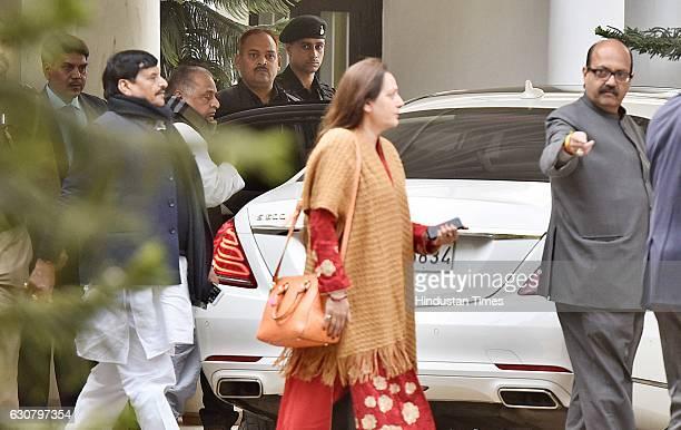 Samajwadi Party Chief Mulayam Singh Yadav with his brother Shivpal Yadav party leaders Jaya Prada and Amar Singh leaves his residence to meet...