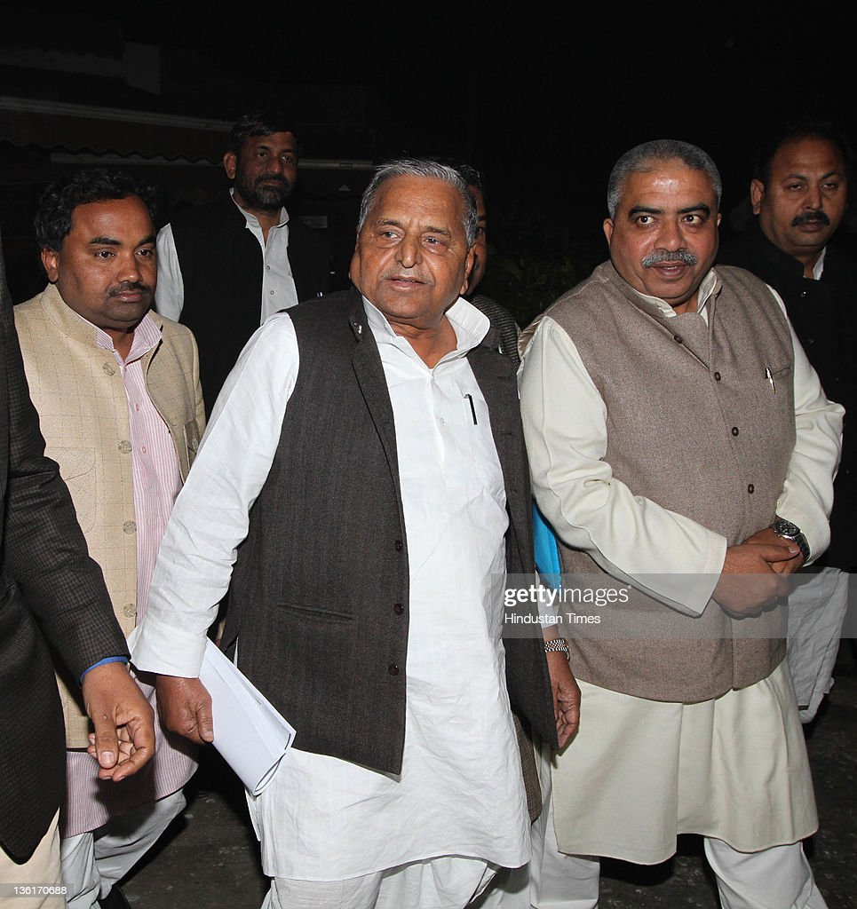 Samajwadi Party chief Mulayam Singh Yadav with his party MPs walk out during the discussion on Lokpal Bill in Lok Sabha at Parliament house on...