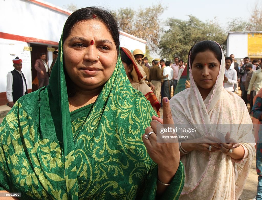 Samajwadi party Chief <a gi-track='captionPersonalityLinkClicked' href=/galleries/search?phrase=Mulayam+Singh+Yadav&family=editorial&specificpeople=689640 ng-click='$event.stopPropagation()'>Mulayam Singh Yadav</a>'s wife Sadhana Yadav (L) shows her ink marked finger after casting her vote at Safai Junior High School during fifth phase of assembly elections in Uttar Pradesh on February 23, 2012 in Etawah, India. Polling for 49 seats, spread over 13 districts of Uttar Pradesh, went on peacefully with more than 59 percent voters exercised their franchise.