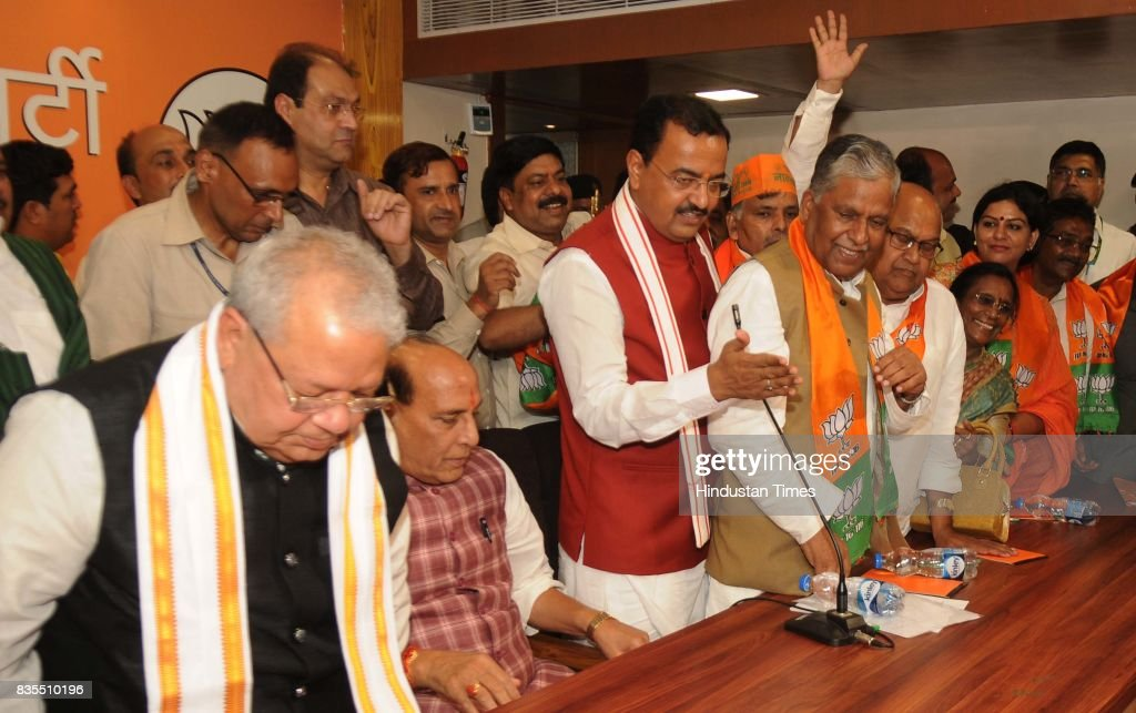 Samajwadi Party former minister Ashok Bajpai (L) joins BJP in presence of Union Home Minister Rajnath Singh, BJP state president & DY CM K.P Maurya & Union Cabinet Minister Sri Kalraj Mishra, on August 19, 2017 in Lucknow, India. On August 9, Bajpai had resigned from his Uttar Pradesh Legislative Council (MLC) seat.