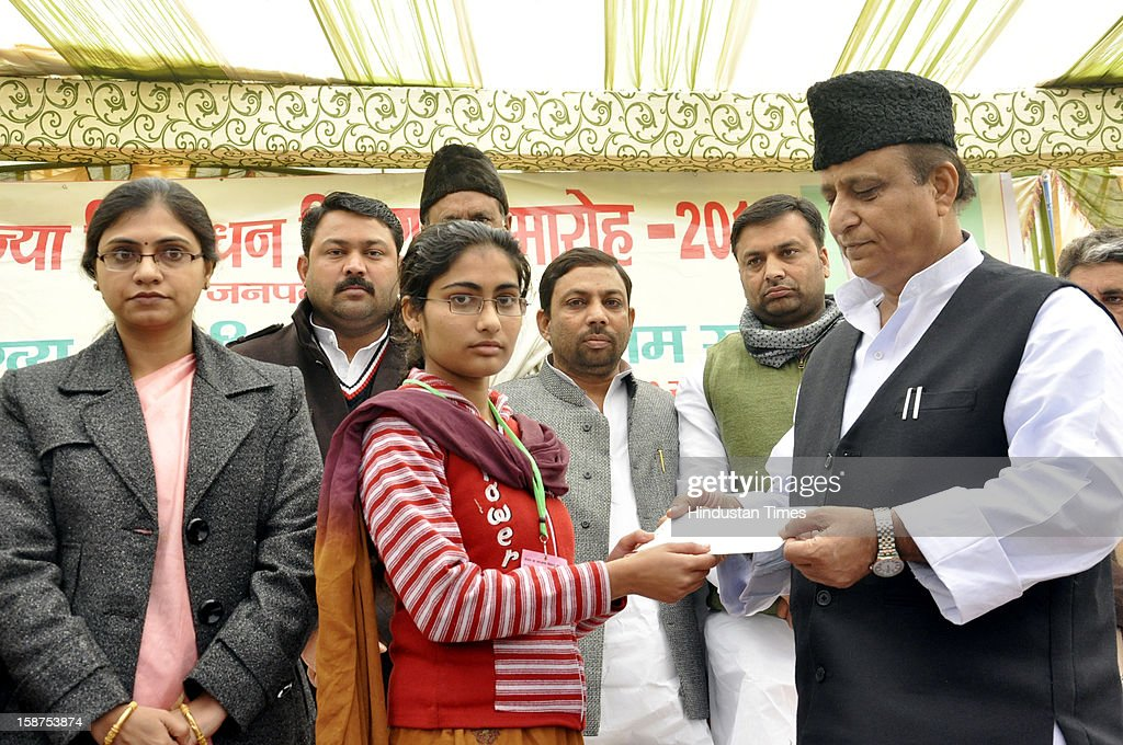 Samajwadi Party leader and Uttar Pradesh Minister Azam Khan distributed 'Kanya Vidya Dhan' cheques to around 1100 girls, on December 27, 2012 in Ghaziabad, India. Under the 'Kanya Vidya Dhan Yojana', the state government gives financial assistance of Rs 30,000 to a girl, from below poverty line family, after she clears class 12th for pursuing higher education.